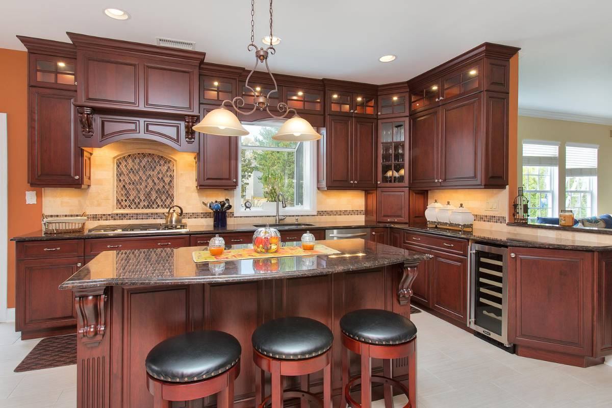 Cherry kitchen cabinets with glass corner cabinet