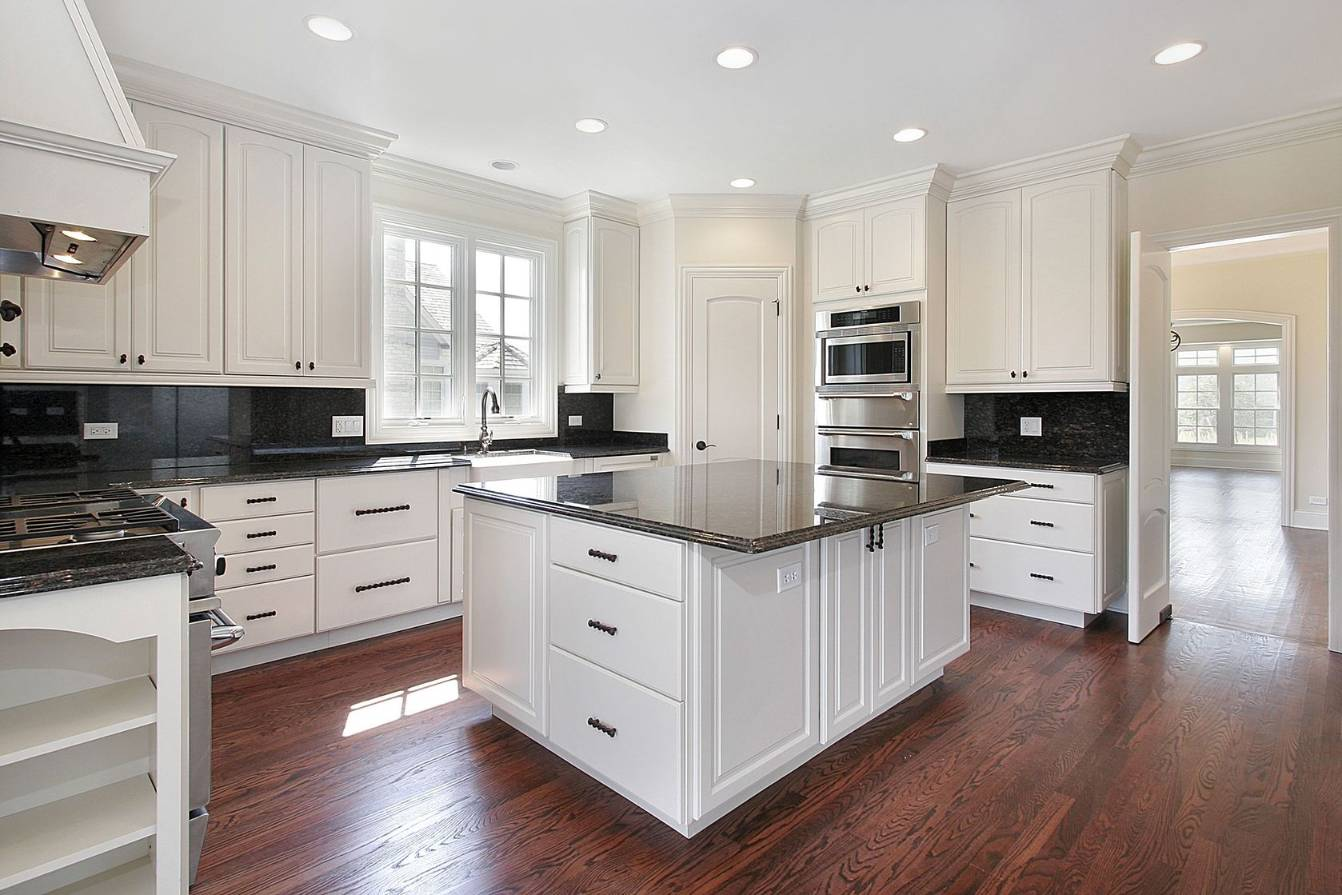 backsplash with black granite and white cabinets