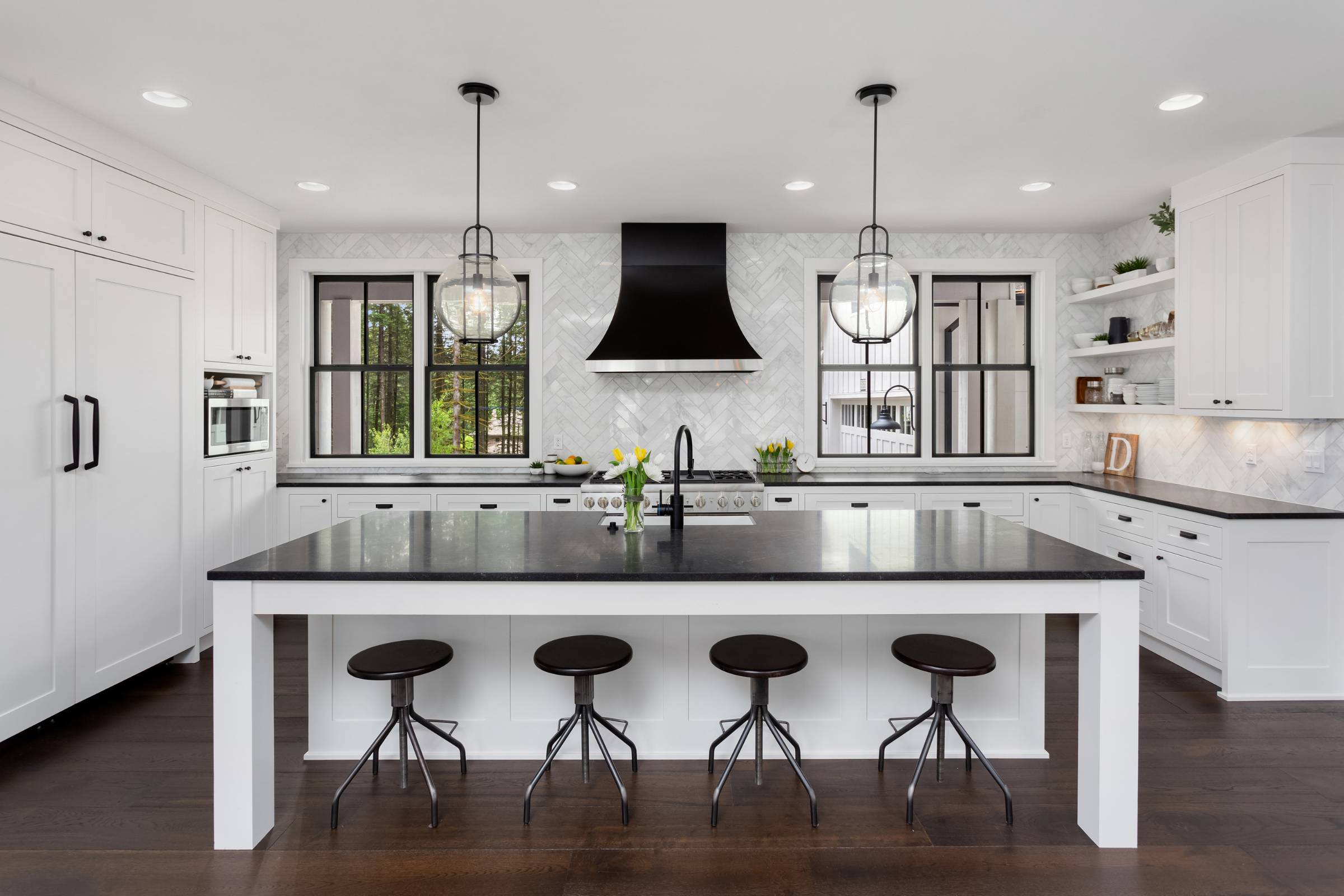 kitchen with white cabinets and black countertops